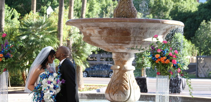 Bride and Groom Behind Fountain